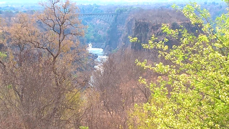 From Victoria Falls Hotel you can see the railroad bridge over the Zambezi river connecting Zimbabwe and Zambia.