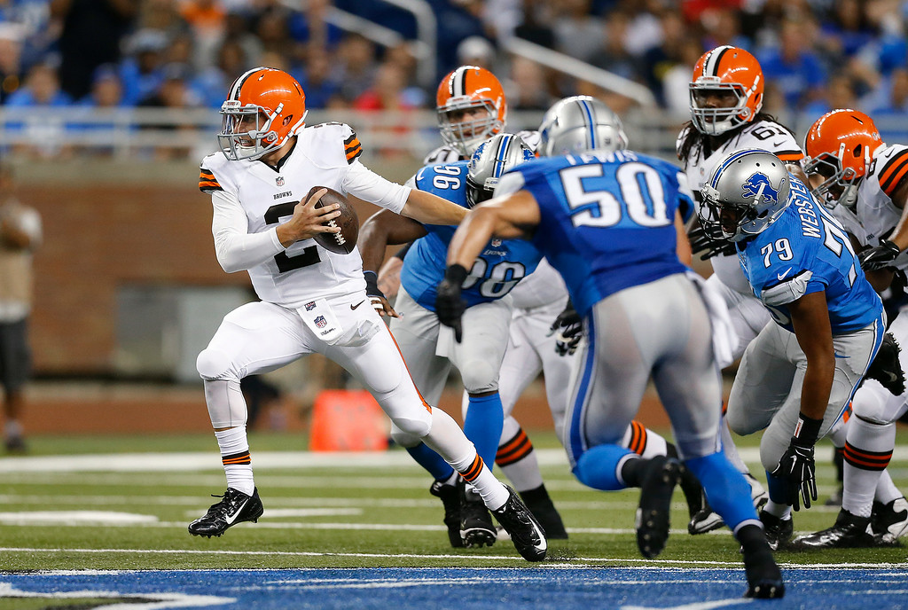 . Cleveland Browns quarterback Johnny Manziel (2) scrambles from the Detroit Lions rush in the second half of a preseason NFL football game at Ford Field in Detroit, Saturday, Aug. 9, 2014. (AP Photo/Rick Osentoski)