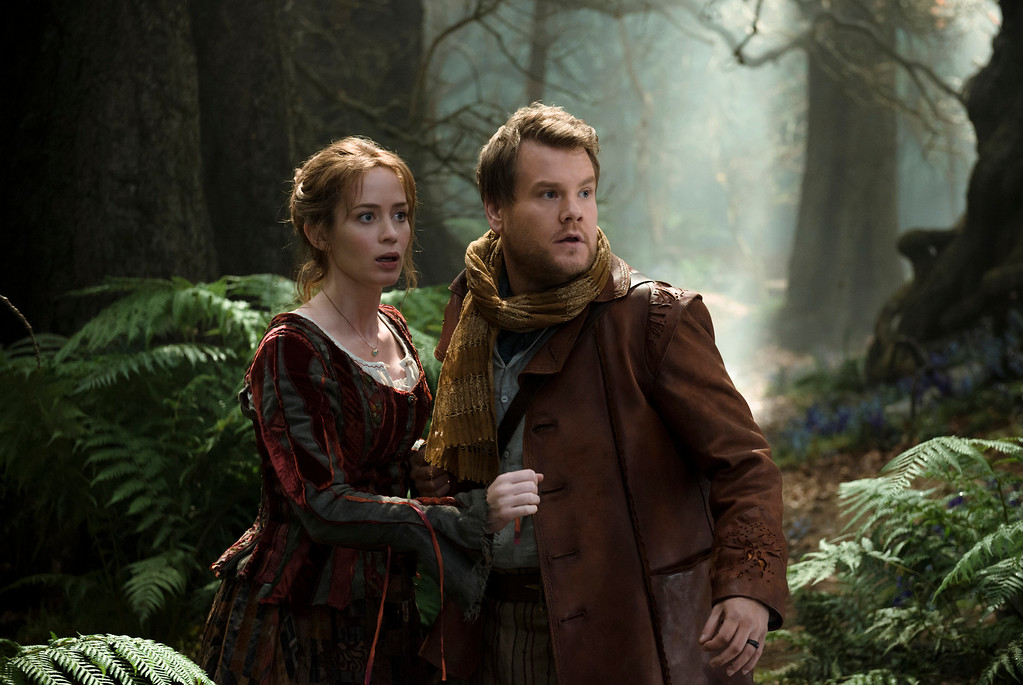 """. In this image released by Disney Enterprises, Inc., Emily Blunt, left, and James Corden star as a baker and his wife who wish to start a family in a scene from \""""Into the Woods.\"""" Blunt was nominated for a Golden Globe for best actress in a comedy or musical for her role in the film on Thursday, Dec. 11, 2014. The 72nd annual Golden Globe awards will air on NBC on Sunday, Jan. 11. (AP Photo/Disney Enterprises, Inc., Peter Mountain)"""