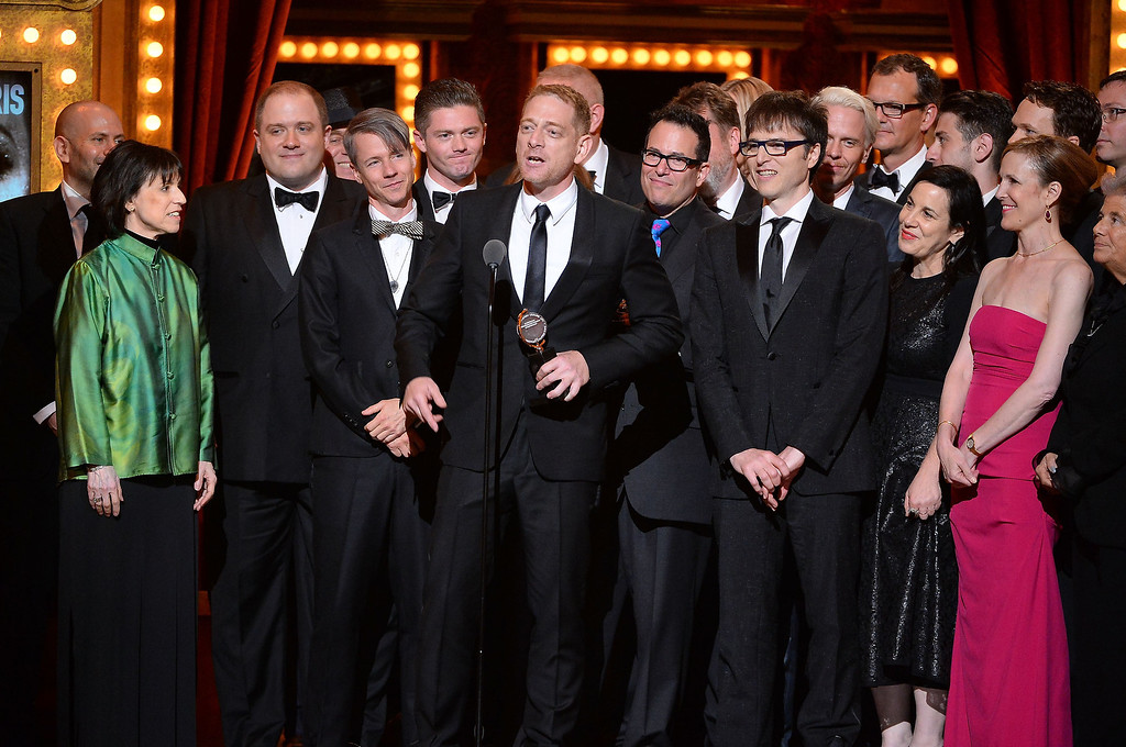 ". Producer David Binder accepts the award for Best Revival of a Musical with the cast of ""Hedwig and the Angry Inch\"" onstage during the 68th Annual Tony Awards at Radio City Music Hall on June 8, 2014 in New York City.  (Photo by Theo Wargo/Getty Images for Tony Awards Productions)"