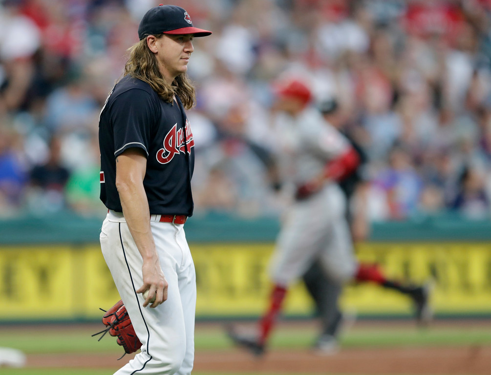 . Cleveland Indians starting pitcher Mike Clevinger, left, waits for Cincinnati Reds\' Joey Votto to run the bases after Votto hit a solo home run in the fifth inning of a baseball game, Monday, July 9, 2018, in Cleveland. (AP Photo/Tony Dejak)