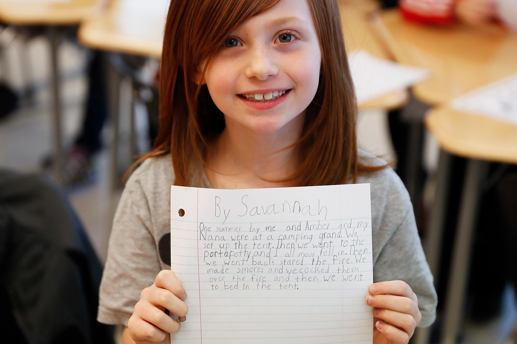 . A student holds up her unfinished homework during an after-school program at Circleville Elementary School, Wednesday, March 29, 2017, in Circleville, Ohio. Circleville school officials said it would be very difficult to keep their after-school programs going if federal funding for the 21st Century Community Learning Centers program is eliminated as proposed by President Donald Trump\'s administration. (AP Photo/John Minchillo)