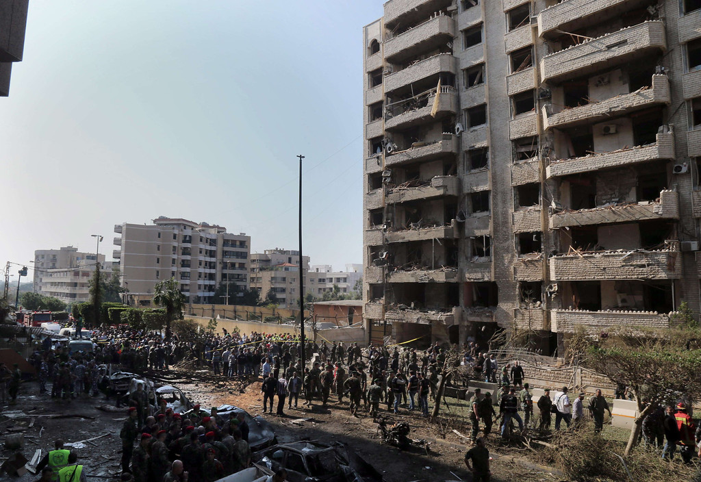 . People gather at the site of a blast in Bir Hassan neighborhood in southern Beirut on November 19, 2013.  AFP PHOTO/STR-/AFP/Getty Images