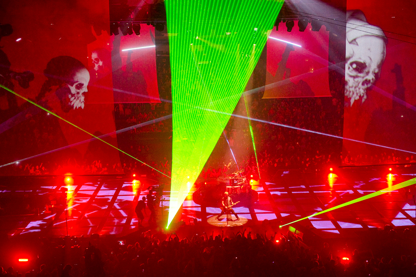 """Description of . Colored lights transform the arena in a scene from """"Metallica: Through the Never."""""""