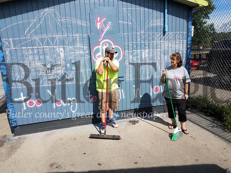 Chris and Cindy Parker stand in front of recently vandalized concession stand in the skate park area of Father Marinaro Park.
