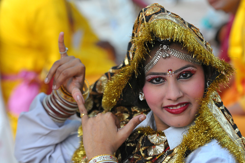 This young girl is the younger sister of Ms. Pallvi who is a dancer with the Haryanvi Group and sitting near the open theatre called Chaupal at Suraj Kund Mela 2009. Held in Haryana (outskirts of Delhi), North India, the Suraj Kund Mela is an annual fair held near Delhi. Folk dances, handicrafts and a lot of fun.