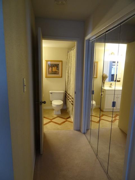 From the master bedroom looking past the closet doors toward the bathroom.