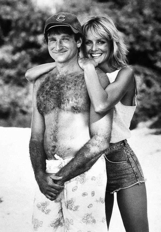 . Actor Robin Williams, left, in character as ex-Chicago fireman Jack Moniker poses with actress and model Twiggy, also in character for the comedy Club Paradise, 1986. (AP Photo/Warner Bros)