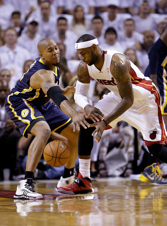 . Indiana Pacers forward David West , left, blocks a pass by Miami Heat forward LeBron James during the first half of Game 4 in the NBA basketball Eastern Conference finals playoff series, Monday, May 26, 2014, in Miami. (AP Photo/Wilfredo Lee)