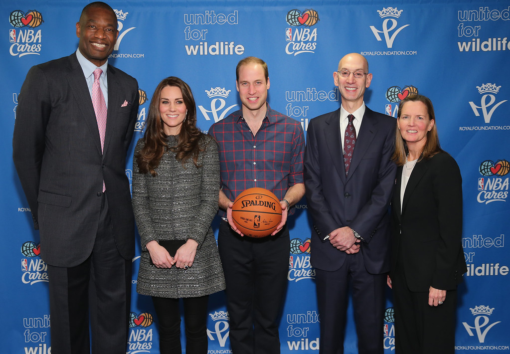 . Prince William, Duke of Cambridge (C) and Catherine, Duchess of Cambridge (2nd L) pose with NBA Commissioner Adam Silver (2nd R), Global Ambassador Dikembe Mutombo (L) and Sr. Vice President, Community & Player Programs Kathleen Behrens (R) as they attend the Cleveland Cavaliers vs. Brooklyn Nets game at Barclays Center on December 8, 2014 in the Brooklyn borough of New York City.  (Photo by Neilson Barnard/Getty Images)