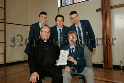 St Colmans College Junior prizegiving. Aaron Recieves his Maths challenge award from Dr Francis Brown. Also in picture are school Prefects, Edward O'Hare, Michael Mulvanny and Gary Buchanan.