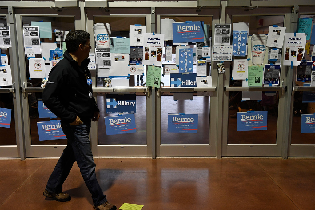 . A man walk past an entrance to the delegate registration area at the Colorado Democratic State Convention at the Budweiser Events Center April 17, 2016. (Photo by Andy Cross/The Denver Post)