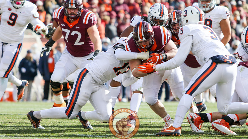Sam Rogers fights through several UVa defenders to the goal line. (Mark Umansky/TheKeyPlay.com