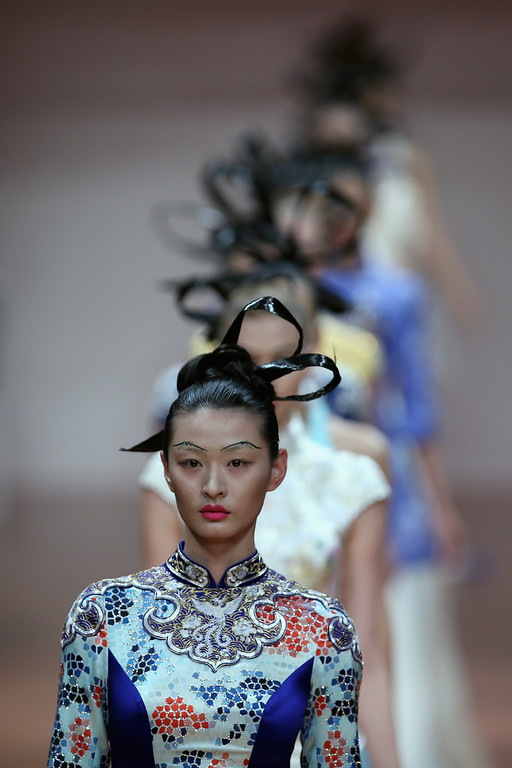 . BEIJING, CHINA - OCTOBER 25:  Models showcase designs by Zhang Zhifeng on the runway at 2014 NE?TIGER Haute Couture Collection show during Mercedes-Benz China Fashion Week Spring/Summer 2014 at Beijing Hotel on October 25, 2013 in Beijing, China.  (Photo by Feng Li/Getty Images)