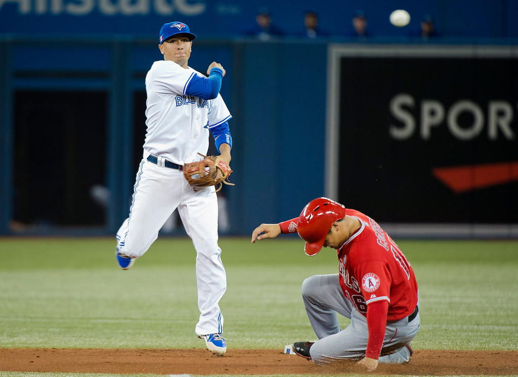 . Toronto Blue Jays second baseman Ryan Goins, left, forces out Los Angeles Angels\' Hank Conger, right, at second base then turns the double play over to first base to get out Angels\' Grant Green during second-inning AL baseball game action in Toronto, Wednesday, Sept. 11, 2013. (AP Photo/The Canadian Press, Nathan Denette)