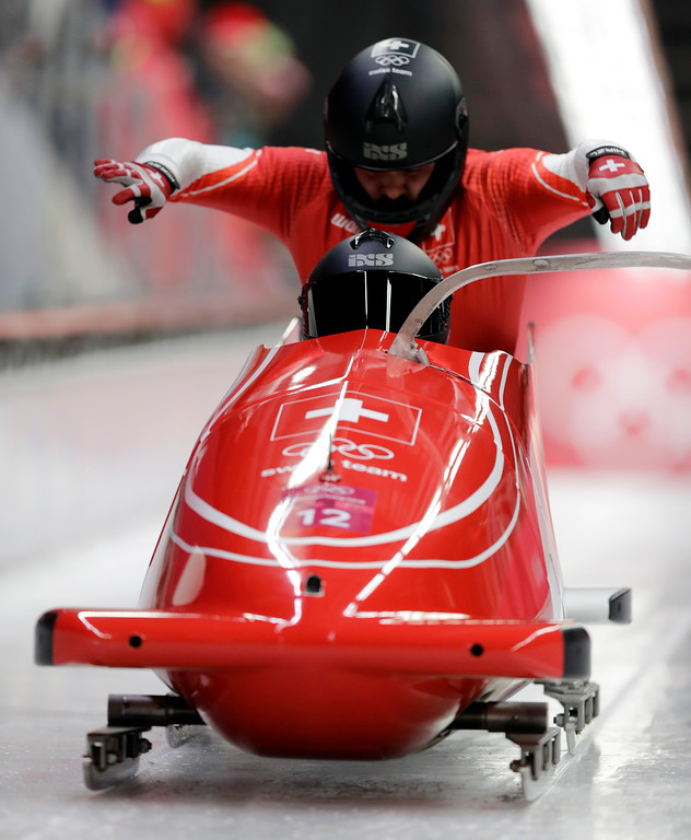 . Driver Rico Peter and Simon Friedli of Switzerland starts their third heat during the two-man bobsled final at the 2018 Winter Olympics in Pyeongchang, South Korea, Monday, Feb. 19, 2018. (AP Photo/Wong Maye-E)