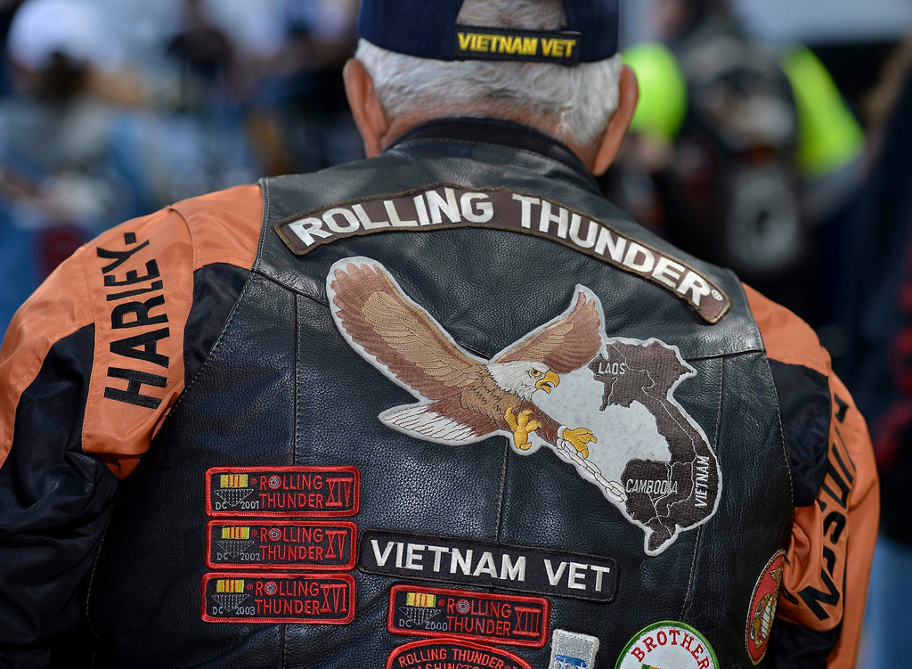 . A Vietnam veteran in black leather and patches watches the proceedings in Fairfax, Virginia, May 25, 2013, as hundreds of thousands of motorcycle riders gather on Memorial Day weekend for the 26th Annual Rolling Thunder Rally on May 26, 2013 to remember POWs and MIAs from America\'s wars, in Washington, May 26, 2013. REUTERS/Mike Theiler