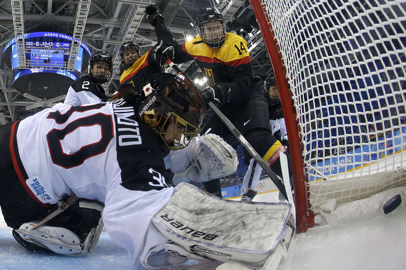 . Japan\'s goalkeeper Nana Fujimoto (L) reacts as Germany scored its first goal during the Women\'s Ice Hockey Classifications match between Germany and Japan at the Shayba Arena during the Sochi Winter Olympics on February 18, 2014.  (MATT SLOCUM/AFP/Getty Images)