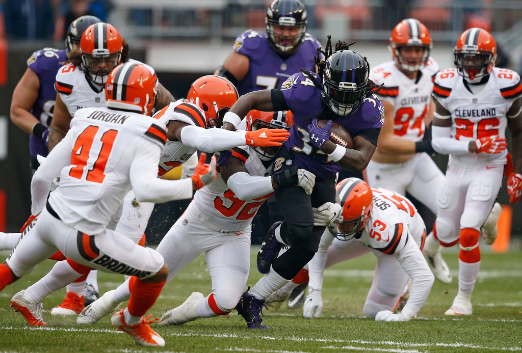 . Baltimore Ravens running back Alex Collins (34) rushes against the Cleveland Browns during the first half of an NFL football game, Sunday, Dec. 17, 2017, in Cleveland. (AP Photo/Ron Schwane)
