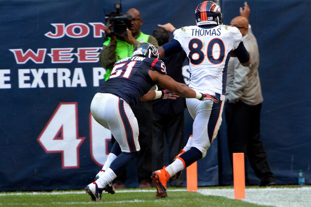 . Tight end Julius Thomas #80 of the Denver Broncos catches a touchdown pass to make the score 36-13  against the Houston Texans at Reliant Stadium December 22, 2013 Houston, Texas. (Photo By Joe Amon/The Denver Post)