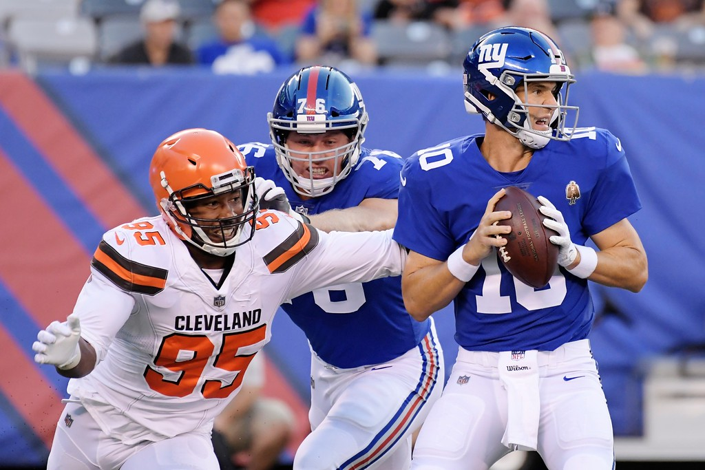 . Cleveland Browns defensive end Myles Garrett (95) rushes New York Giants\' Eli Manning (10) during the first half of a preseason NFL football game Thursday, Aug. 9, 2018, in East Rutherford, N.J. (AP Photo/Bill Kostroun)