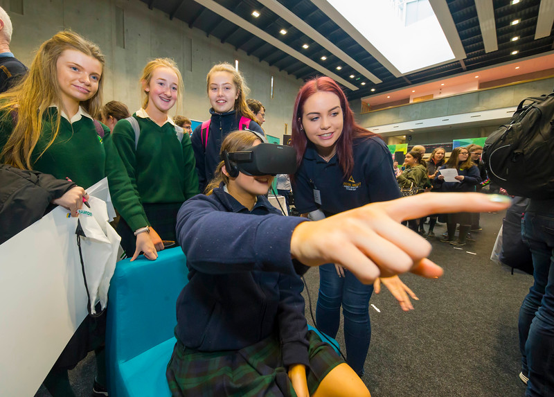 """09/11/2017. Crystal Valley Tech Showcase at WIT Arena. Pictured is Grainne Flannery from St Mary's Secondary School, New Ross Co. Wexford with Claire Coppinger from Bluefin with a VR Head Set. Picture: Patrick Browne  with Grainne Flannery from St Mary's Secondary School, New Ross Co. Wexford. Picture: Patrick Browne   Event demonstrates Tech and ICT is thriving in Wexford and the South East 50 companies and 2,000 students, industry and recruiters attend the inaugural Crystal Valley Tech Showcase event  Over 50 companies who are working together as Crystal Valley Tech showcased their rapidly growing industry in the WIT Arena on Thursday morning to approx. 2,000 members of the public, college and second level students, recruiters, government agencies and other industry.  The future is bright for ICT in the South East according to Dr Padraig Kirwan, Head of the Department of Computing & Mathematics at Waterford Institute of Technology. """"Computing is thriving in the South East judging by the number and diversity of ICT companies here today. Even more encouraging is the number of second level students who attended from Waterford, Kilkenny, Carlow, Tipperary and Wexford and how interested they are about the career opportunities in this exciting industry.""""  Wexford schools attending the event included St. Mary's CBS in Enniscorthy, St Mary's Secondary School in New Ross and Colaiste an Atha in Kilmuckridge.  Elaine Fennelly, Bluefin Payment Systems General Manager and co-founder of Crystal Valley Tech is very excited about the industry in the South East and today's showcase event. """"People who work in the industry already know that Tech is well established in the South East and the number of opportunities and companies continues to grow and grow. According to a recent Tech Ireland report there are over 60 indigenous and multinational companies employing well over 1,500 people from their bases in Waterford, Wexford, Kilkenny and Carlow.  """"However, we weren�"""