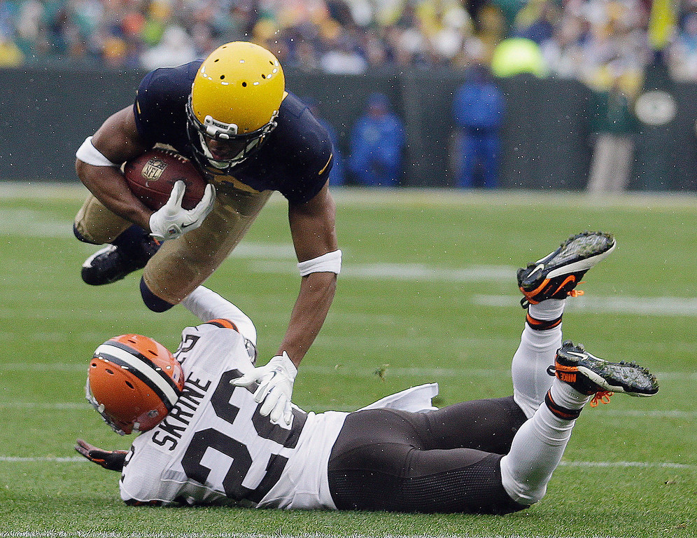 . Green Bay Packers\' Jarrett Boykin is tripped up by Cleveland Browns\' Buster Skrine after a catch during the first half of an NFL football game Sunday, Oct. 20, 2013, in Green Bay, Wis. (AP Photo/Morry Gash)