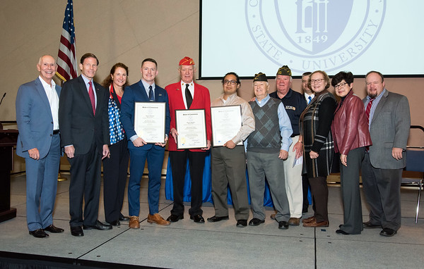 11/12/18 Wesley Bunnell | Staff CCSU held a Veterans Day Observance on Monday afternoon in Alumni Hall which featured honoring three local veterans. CSCU President Mark Ojakian, Senator Richard Blumenthal, Congresswoman Elizabeth Esty, Honoree Joshua Barnett, Honoree Jack Truhan, Honoree Mike Curiel, two VFW post members, State Senator Terry Gerratana, CCSU President Zulma Toro and Rep. Rick Lopes.