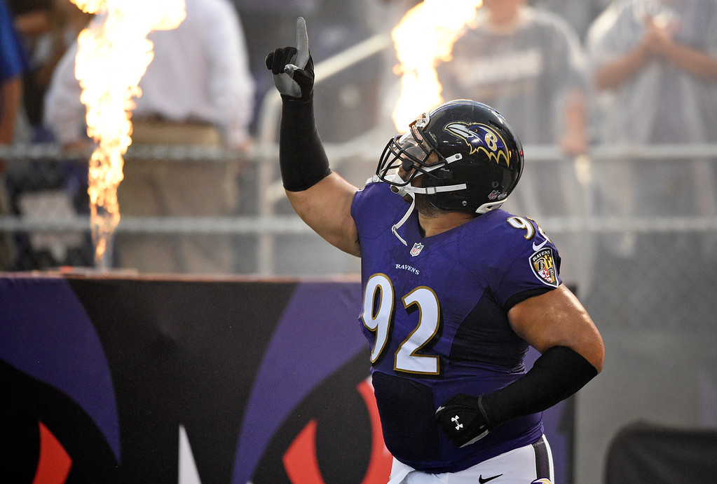 . Baltimore Ravens nose tackle Haloti Ngata runs onto the field as he is introduced before an NFL preseason football game against the Washington Redskins, Saturday, Aug. 23, 2014, in Baltimore. (AP Photo/Nick Wass)