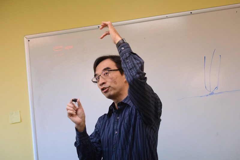mr.sze wong who teaches tech discovery.He is standing in his classroom