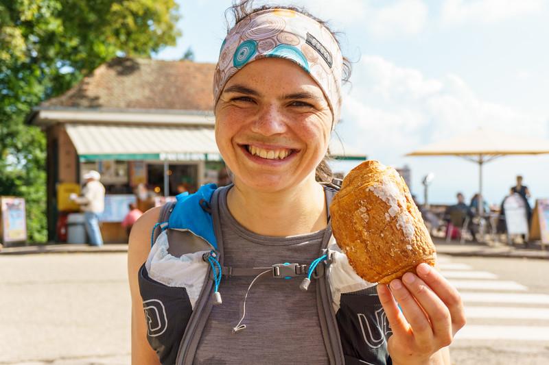 Daphnee Tuzlak enjoys a mid-run croissant at Chateau Haut-Koenigsburg.