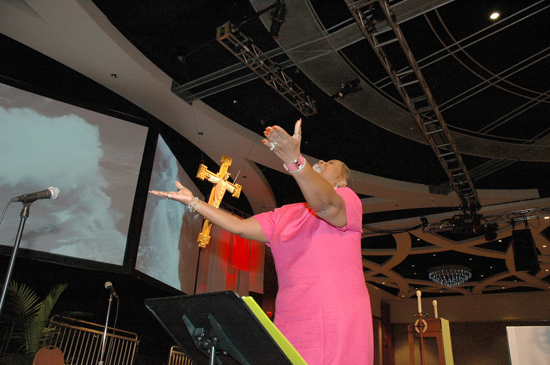 Ms. Roxie Wilson leads the Detroit Lutheran Coalition Mass Choir at Tuesday's worship.