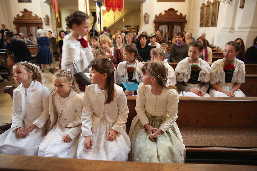 . Girls and young women dressed in traditional Bavarian folk costumes arrive for the annual Corpus Christi (in German called Fronleichnam) mass at St. Michael\'s Church on May 30, 2013 in Seehausen am Staffelsee, Germany. The Seehausen Corpus Christi celebration usually includes a procession to a chapel across the nearby Staffelsee lake, though rain forced organizers to cancel the lake procession this year. Corpus Christi is among the highlights of the Catholic religious calendar in Bavaria.  (Photo by Sean Gallup/Getty Images)