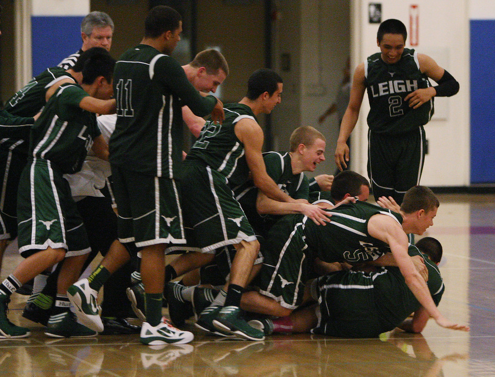 . Leigh players fall to the floor after winning the Blossom Valley Athletic League boys basketball championship game at Independence High School in San Jose, Calif. on Friday, Feb. 15, 2013. The Leigh longhorns beat the Piedmont Hills Pirates, 61-54, in overtime. (Jim Gensheimer/Staff)