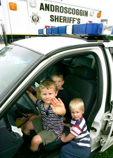 boysINcopcar.jpg
