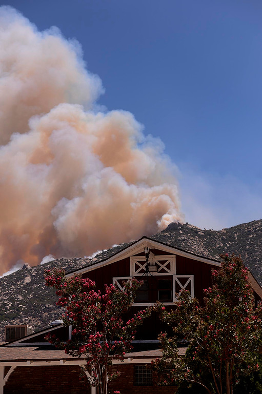 . Smoke from the Silver Fire billows behind Twin Pines Ranch in the mountains south of Banning August 8, 2013.   GABRIEL LUIS ACOSTA/STAFF PHOTOGRAPHER.
