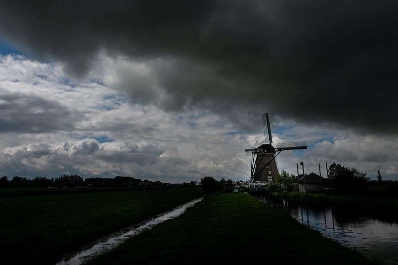 Windmill under dark clouds