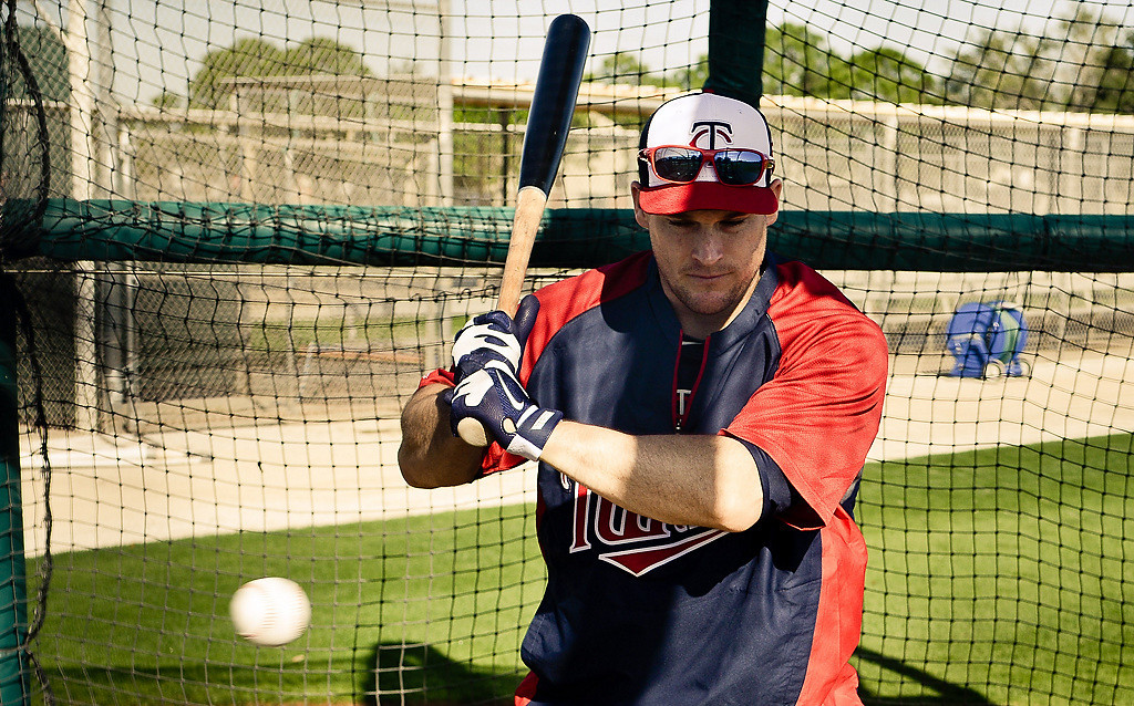 . Twins outfielder Josh Willingham looks at a pitch during batting practice on his first day in camp. (Pioneer Press: Ben Garvin)
