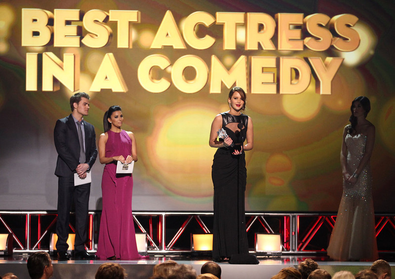 """. Jennifer Lawrence accepts the award for best actress in a comedy for \""""Silver Linings Playbook\"""" at the 18th Annual Critics\' Choice Movie Awards at the Barker Hangar on Thursday, Jan. 10, 2013, in Santa Monica, Calif.  (Photo by Matt Sayles/Invision/AP)"""
