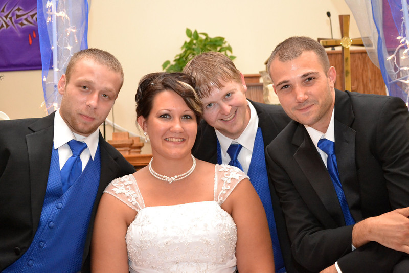 Bride and three of the groomsmen.