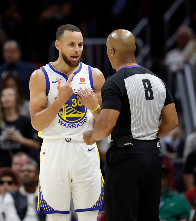 . Golden State Warriors\' Stephen Curry questions referee Marc Davis (8) in the first half of Game 3 of the basketball team\'s NBA Finals against the Cleveland Cavaliers, Wednesday, June 6, 2018, in Cleveland. (AP Photo/Tony Dejak)