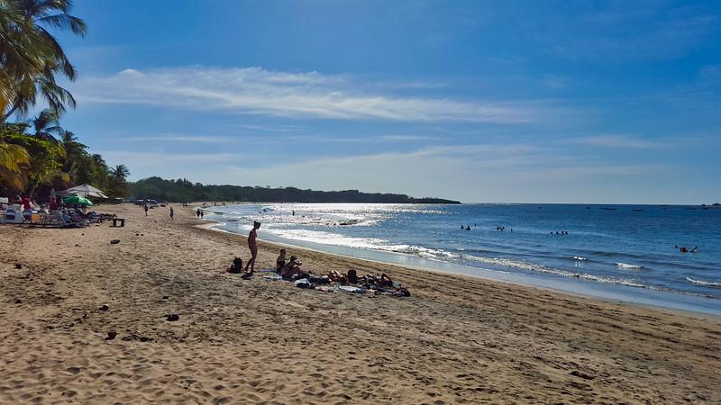 People sitting in the beach in Tamarindo, Costa Rica