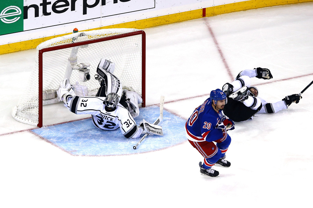. Jonathan Quick #32 and Drew Doughty #8 of the Los Angeles Kings lie on the ice after a play at the net against Chris Kreider #20 of the New York Rangers during the third period of Game Three of the 2014 NHL Stanley Cup Final at Madison Square Garden on June 9, 2014 in New York, New York.  (Photo by Al Bello/Getty Images)