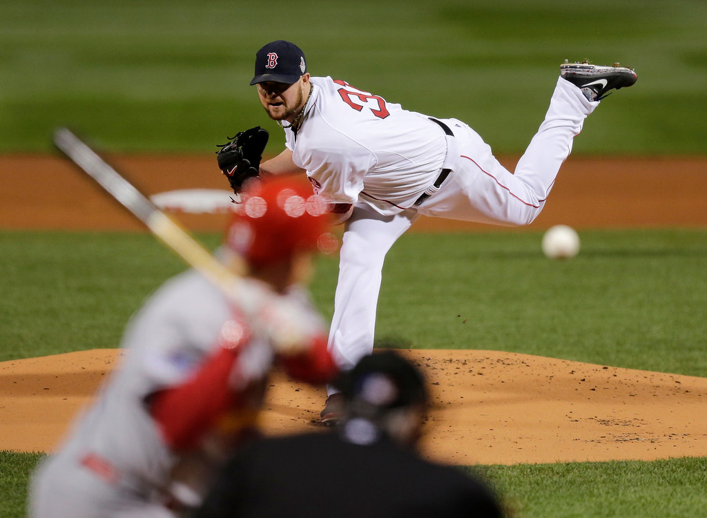 . Boston Red Sox starting pitcher Jon Lester throws during the first inning of Game 1 of baseball\'s World Series against the St. Louis Cardinals Wednesday, Oct. 23, 2013, in Boston. (AP Photo/Charles Krupa)