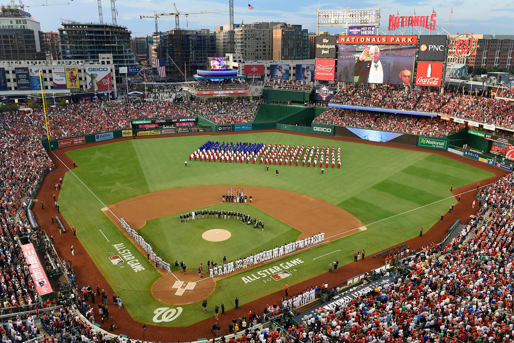 . A choir moves on the field before the 89th MLB baseball All-Star Game, Tuesday, July 17, 2018, at Nationals Park, in Washington. (AP Photo/Susan Walsh)
