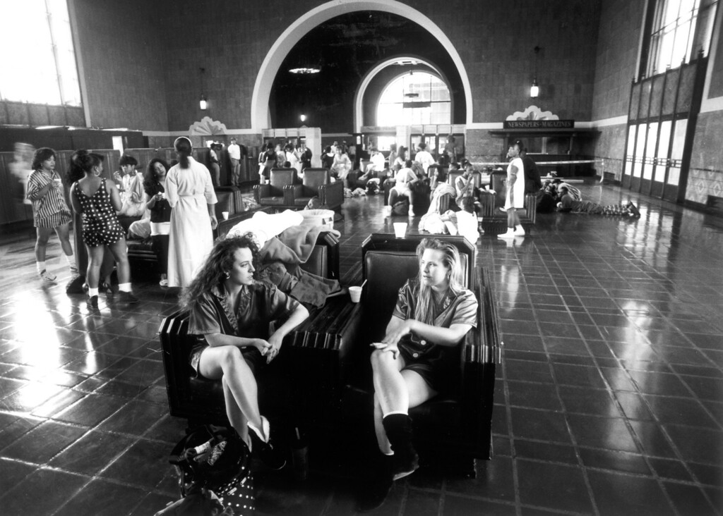 ". In the waiting area, with double chairs, actresses Victoria Fleming, left, and Mary Johnson wait to film their scene in ""House Party 2\"" on April 30, 1991.    (Los Angeles Daily News file photo)"
