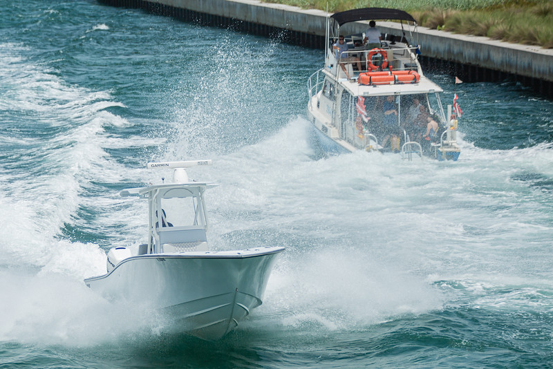 A heading out of the Boynton Inlet in Boynton Beach jumps the wake of a returning boat, Sunday, June 28, 2020. [JOSEPH FORZANO/palmbeachpost.com]