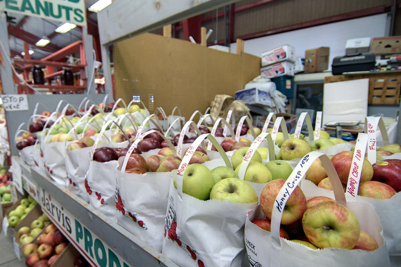 Bags of fresh apples from Jarvis Produce at the Western North Carolina Farmer's Market in Asheville, NC on Sunday, November 3, 2013. Copyright 2013 Jason Barnette  The WNC Farmer's Market is open daily year-round, providing a place for local farmers and artisans to sell their goods throughout the year. The market was opened in 1977 and consists of 38,000 square feet of retail space, five open-air truck sheds with 194 spaces, a small dealers building, and two wholesale buildings.