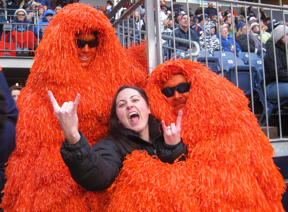 . Broncos fan Jen Burrell demonstrating her excitement with the Broncos Pom Pom Guys. David Goetz