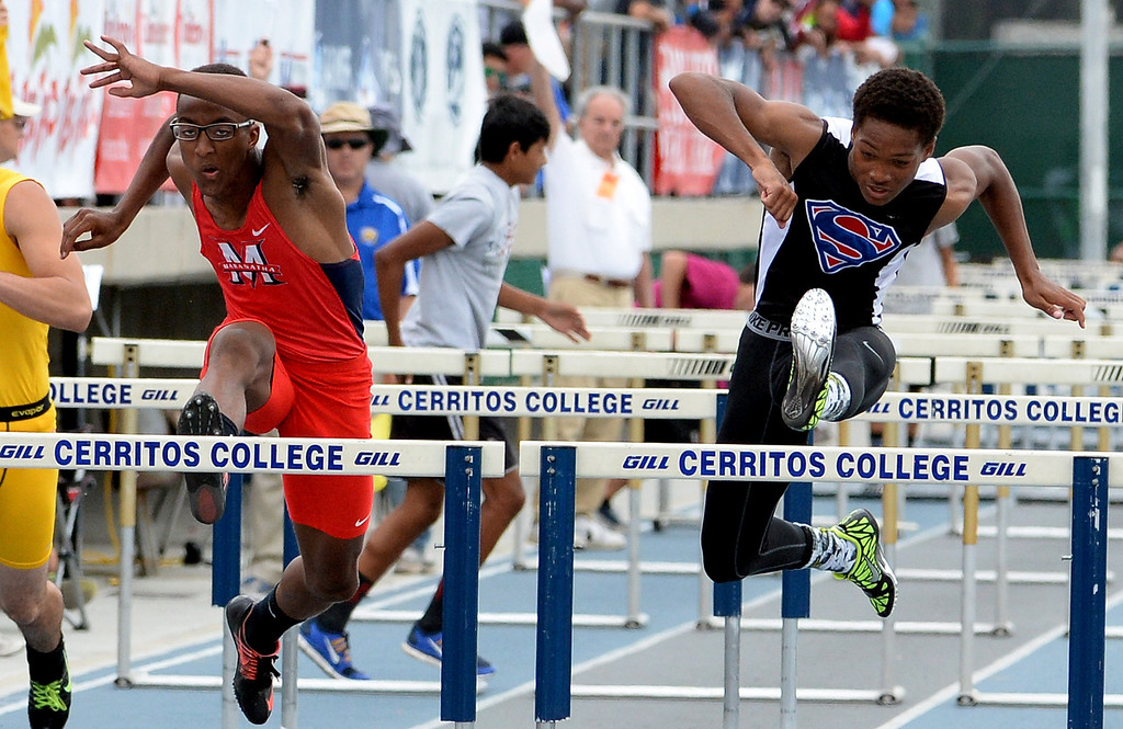 . Maranatha\'s Baron Burems, left, along with Serra\'s Zinovian Cannady competes in the division 4 110 meter high hurdles during the CIF Southern Section track and final Championships at Cerritos College in Norwalk, Calif., Saturday, May 24, 2014.   (Keith Birmingham/Pasadena Star-News)